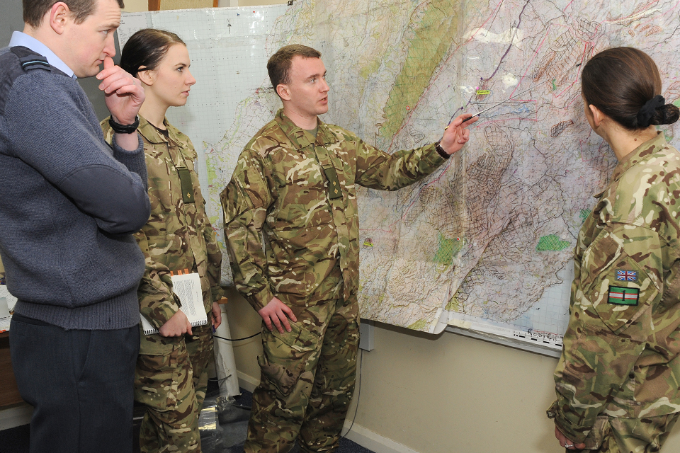 Army reservists work together with RAF officers on a military intelligence exercise