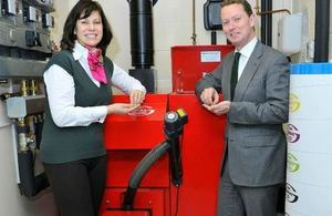 Minister for Energy Greg Barker with a Grants biomass boiler and Claire Perry MP. Grants is in Claire Perry's constituency.