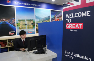 New Visa centre employee testing out latest customer cubicles.