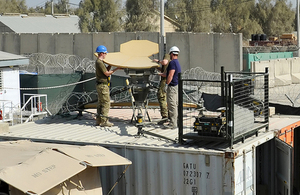 RAF personnel dismantle Reacher satellite equipment at Kandahar airfield [Picture: Sergeant Ross Tilly RAF, Crown copyright]