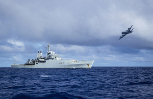 A Royal Australian Air Force AP-3C Orion aircraft passes over HMS Echo [Picture: Crown copyright]