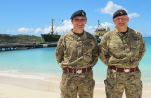 WO2 Carl Green & Maj Andy Nixon MBE in front of the jetty at Road Bay, Anguilla