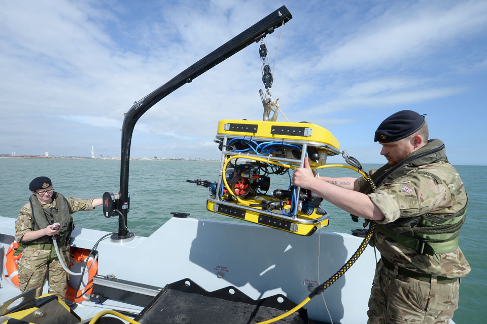 Royal Navy personnel with a submersible mine countermeasures vehicle