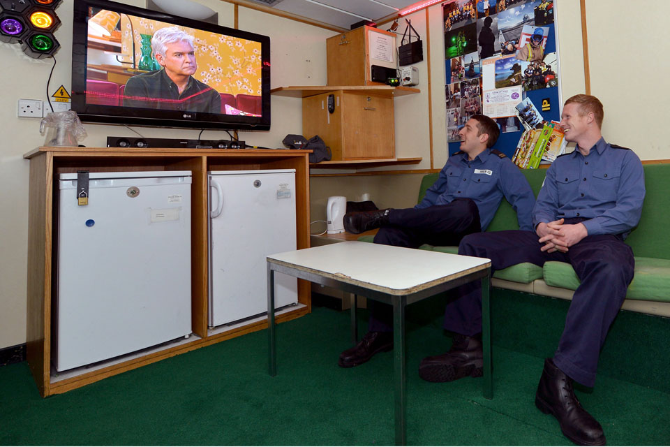 Sailors watching TV in a junior rates' mess
