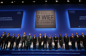 Leaders pose for a group photograph during the Opening Ceremony at the 9th WIEF.