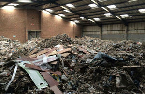 Hundreds of tons of fly-tipped waste inside warehouse