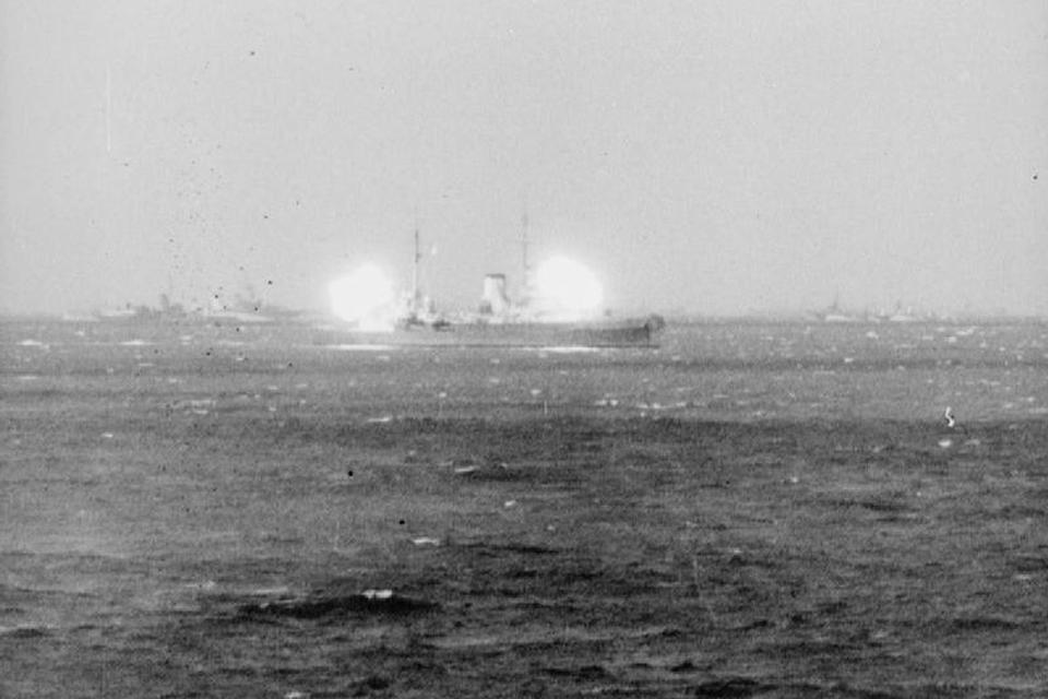 HMS Orion firing a broadside