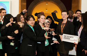 Representatives from the Naz Legacy Foundation, and children, hold up their Big Society Award.