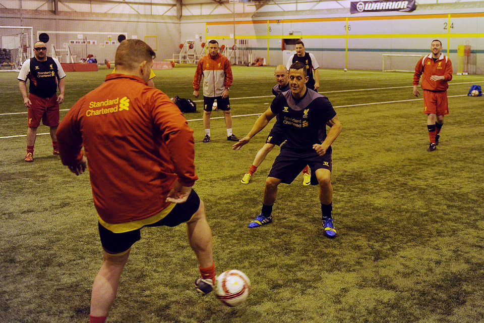 Armed forces veterans enjoy a football coaching session