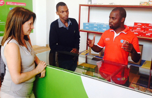 International Development Minister Lynne Featherstone talking to a shopkeeper in Mozambique. Picture: Julia Smith/DFID