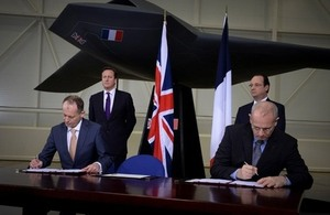 Dr David Parker, CEO of UK Space Agency and Jean-Yves Le Gall, President of CNES sign agreement on closer relationship on space projects overseen by Prime Minister David Cameron and French Presendent Hollande.