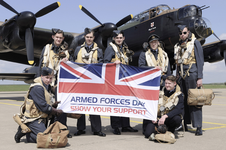 A re-enactment group show their support for Armed Forces Day