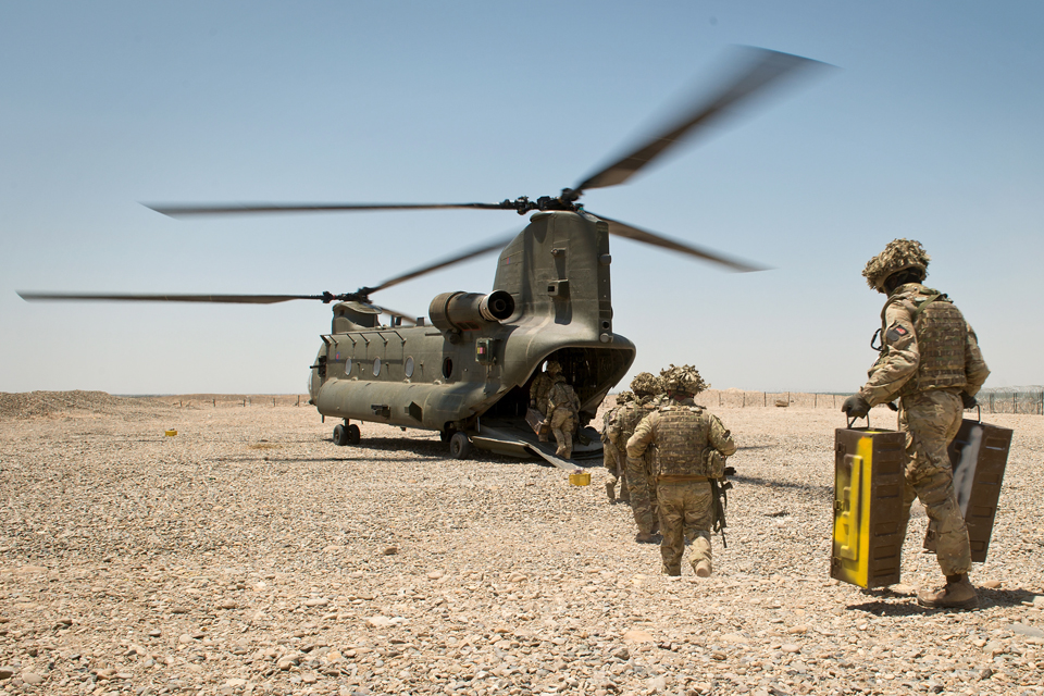 Soldiers boarding an RAF Chinook helicopter