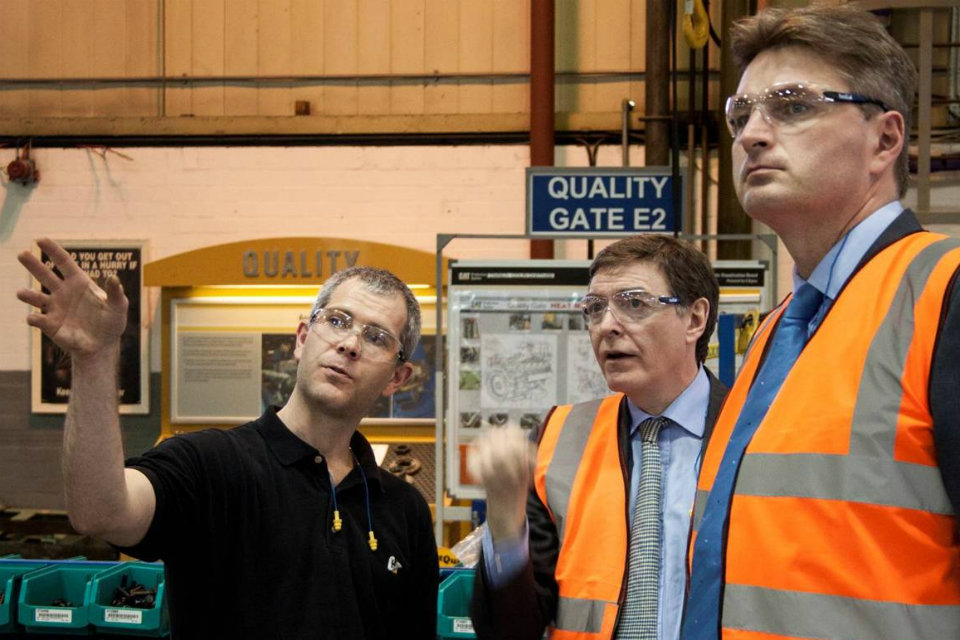 Philip Dunne and Daniel Kawczynski join the post-event tour of the Caterpillar factory