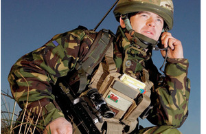 A soldier using a headset to communicate with his colleagues