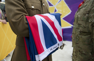 A member of the Royal Gurkha Rifles carries an Australian flag prior to a flag-raising ceremony at the London 2012 Olympic Games (library image) [Picture: Sergeant Alison Baskerville, Crown copyright]