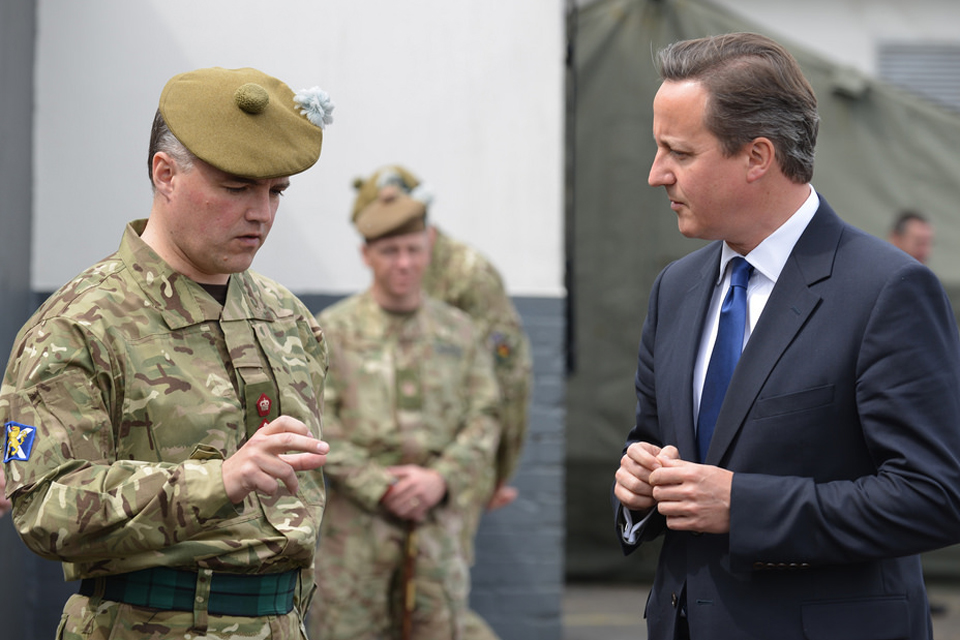 Prime Minister David Cameron talking to a member of 6th Battalion The Royal Regiment of Scotland