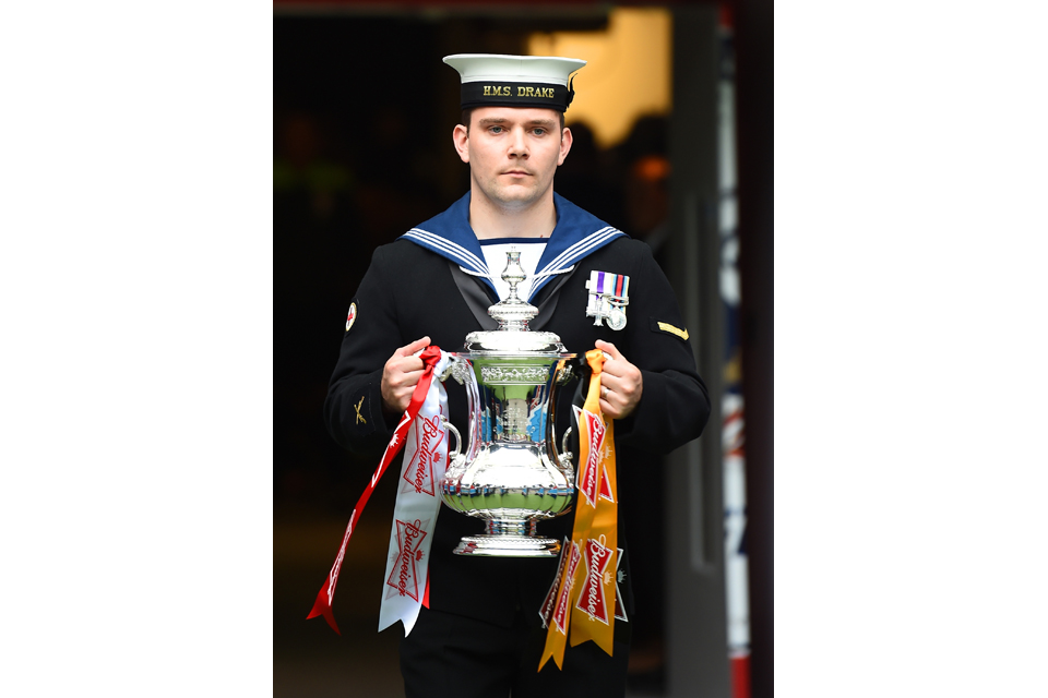 Medical Assistant Liam O'Grady with the FA Cup trophy