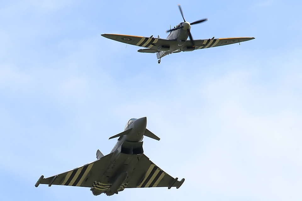 A Typhoon in flight with a Spitfire