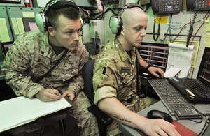 Aerospace Battle Managers Corporal Bobby Howard, US Marine Corps, and Corporal Paddy Bonner, Royal Air Force, working together at Camp Leatherneck, Helmand province, southern Afghanistan