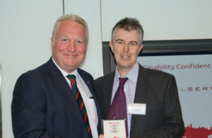 Minister for Disabled People Rt. Hon. Mike Penning presented the award to the Civil Service Diversity & Inclusion team