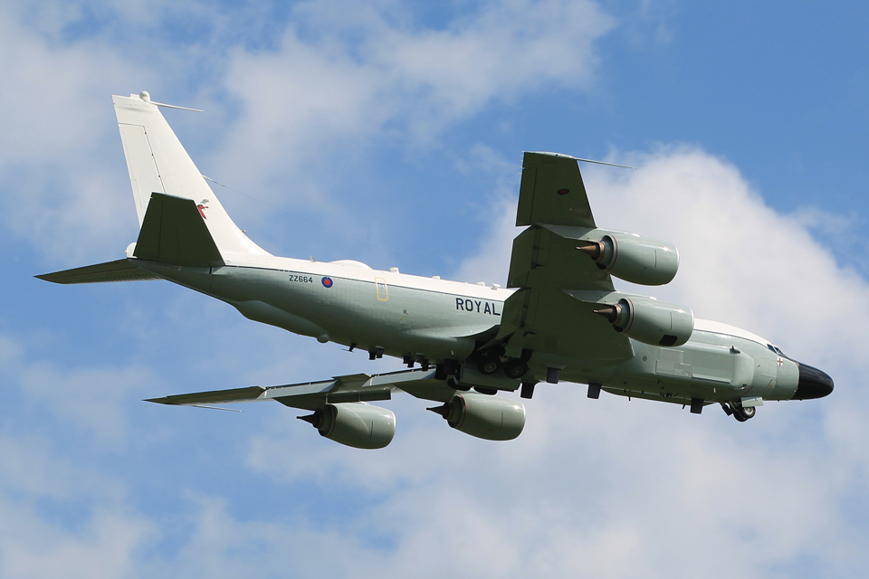 A Rivet Joint RC-135W aircraft in flight over RAF Waddington
