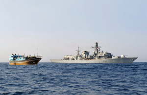 HMS Somerset alongside the dhow [Picture: Leading Airman (Photographer) Nicky Wilson, Crown copyright]