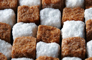 Brown and White sugar cubes arranged in a row
