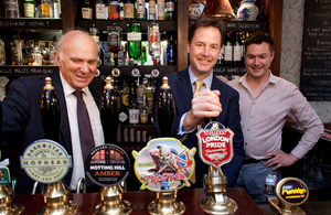 Nick Clegg and Vince Cable behind a bar.