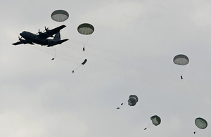 British and US soldiers jump from a Hercules transport plane [Picture: Richard Watt, Crown copyright]