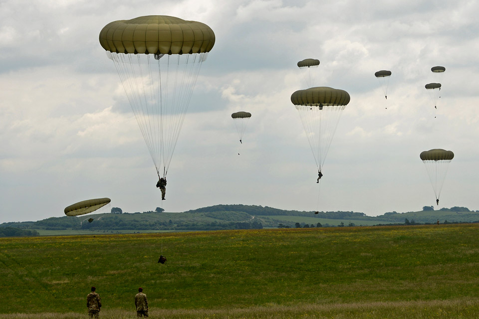 British and US soldiers parachute onto Salisbury Plain