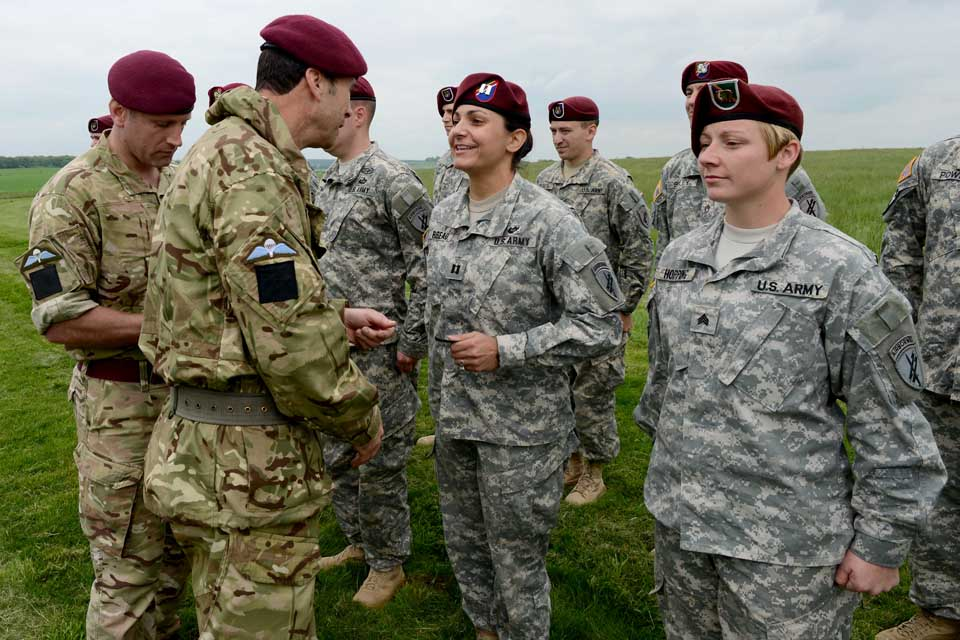 Major General Ranald Munro awards US paratroopers their British wings