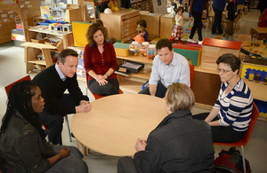 Prime Minister David Cameron and Deputy Prime Minister Nick Clegg visit a nursery.