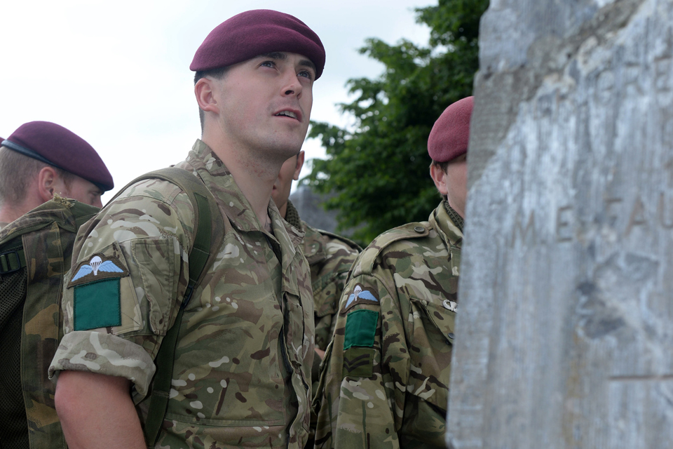 Paratroopers at a cemetery in Breville