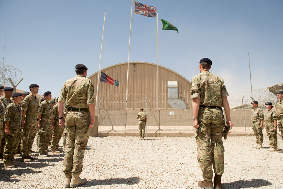 The flag of the incoming command team is raised at Camp Bastion