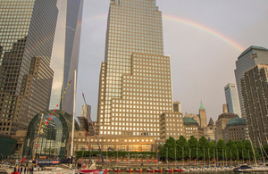 After a rainy evening, a rainbow appeared over the Freedom Tower and the GREAT Britain yacht.