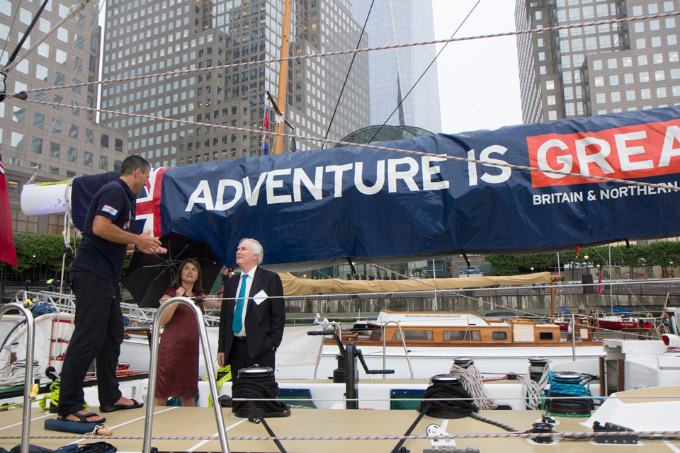 Sir Mark Lyall Grant and Lady Sheila Lyall Grant take a tour of the boat from one of the crew members.