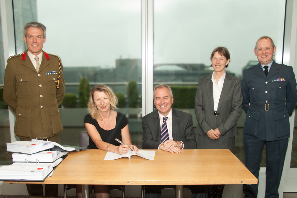 Signing the contract awarding construction of the college to Skanska