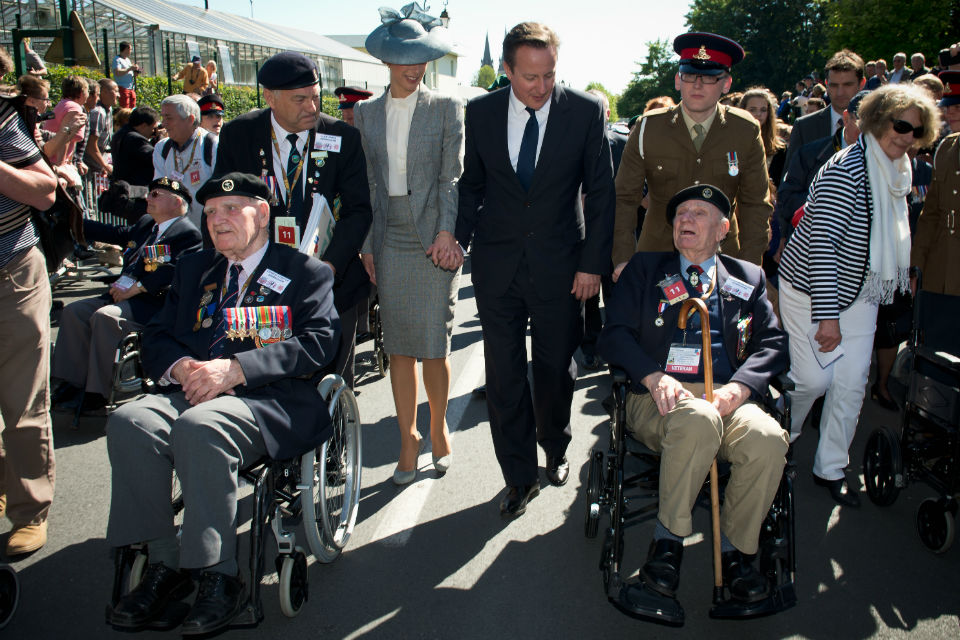 Prime Minister David Cameron and Samantha Cameron with veterans at Bayeux Cemetery.