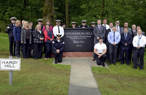 Members of the Churchill community are joined by project managers and contractors for the plaque unveiling [Picture: Crown copyright]