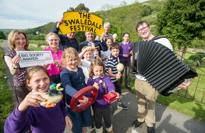 Workers and volunteers for the Swaledale Festival hole up their big society award.