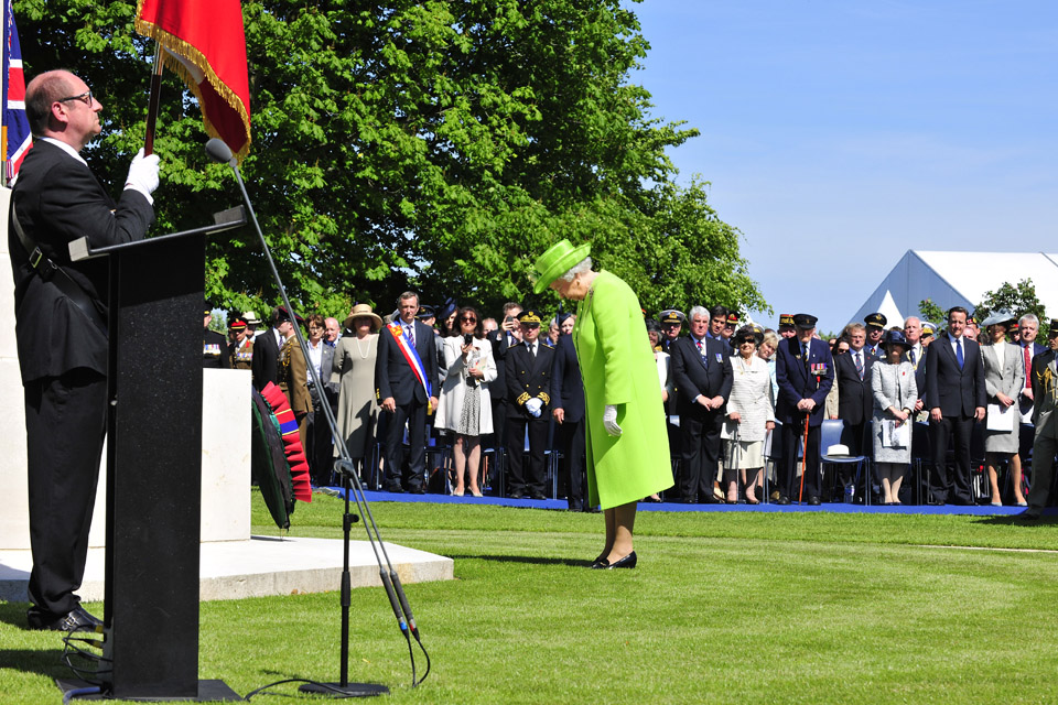 Her Majesty The Queen lays a wreath at Bayeux War Cemetery