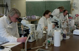 Scientists analyse samples during a Government Chemist training course.