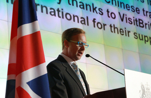 Brian Davidson presented opening remarks at the Queen's Birthday Party in Shanghai.