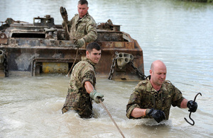 Royal Electrical and Mechanical Engineers reservists work to extract a vehicle from a lake [Picture: Shane Wilkinson, Crown copyright]