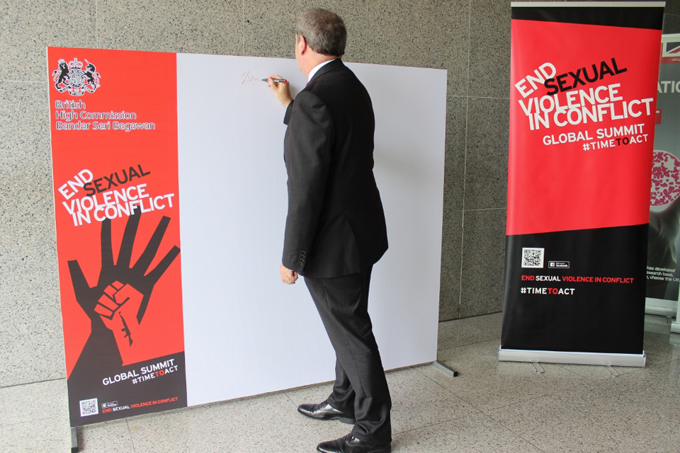 British High Commissioner David Campbell signing the board
