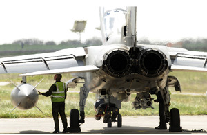 A member of Royal Air Force ground crew checks a Tornado aircraft at Gioia del Colle air base in southern Italy