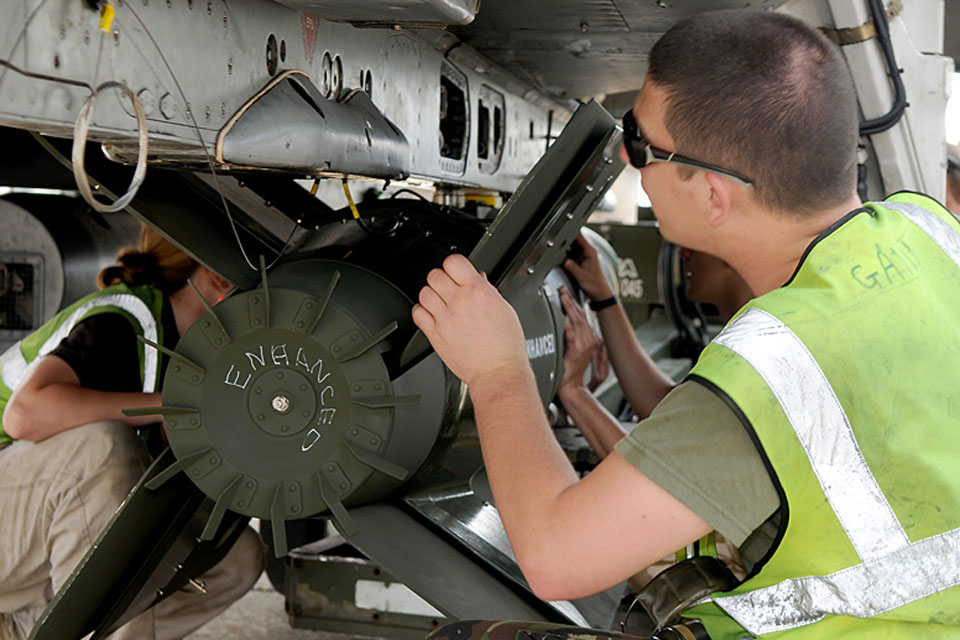 RAF armourers load Enhanced Paveway III bombs onto aircraft at Gioia del Colle air base in southern Italy