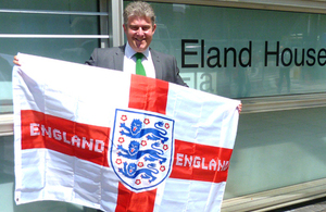 Brandon Lewis with the Three Lions flag