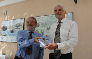 Governor Beckingham (right) is presented with a full set of the booklets by Dr Mike Pienkowski.